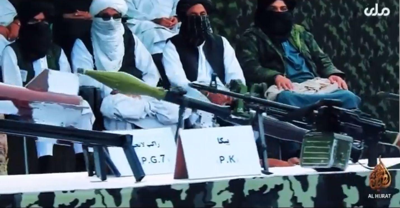 increible desfile taliban por tv en afganistan con chalecos suicidas