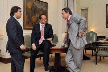 Daniel Scioli junto a Alberto Pérez y a Ricardo Casal, en una postal de 2011.