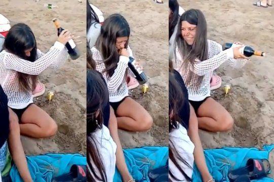 ¿como destapar un vino sin sacacorchos? mira el curioso metodo que uso una turista en la playa